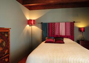 A bed or beds in a room at Cocoon Eco Design Lodges