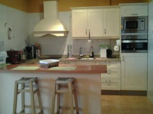 A kitchen or kitchenette at Casa Marechen Gilbert