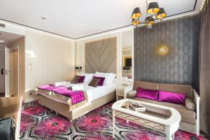 Łóżko lub łóżka w pokoju w obiekcie Hotel Royal Baltic 4* Luxury Boutique