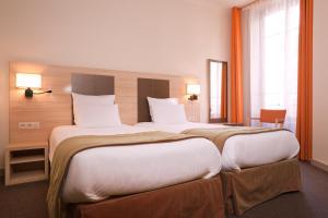 Un ou plusieurs lits dans un hébergement de l'établissement Mercure Lyon Centre Brotteaux