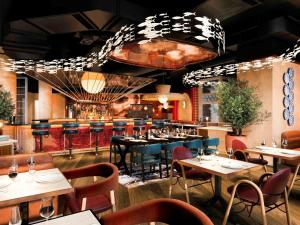 A restaurant or other place to eat at Mondrian London Shoreditch