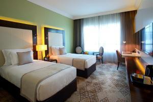 Säng eller sängar i ett rum på Elite Byblos Hotel