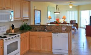 A kitchen or kitchenette at Sunset Vistas Two Bedroom Beachfront Suites