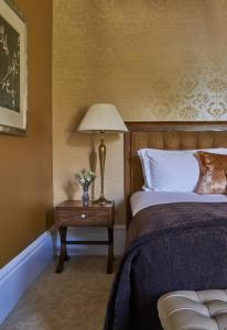 A bed or beds in a room at Rockliffe Hall Hotel Golf & Spa