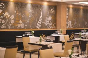 A restaurant or other place to eat at DiplomaticHotel