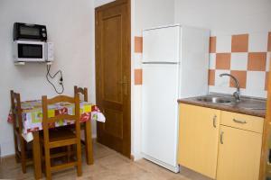 Een keuken of kitchenette bij Villa la Dehesa