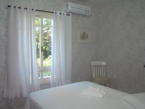 Cama ou camas em um quarto em Bela Vista Vale I