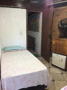 Cama ou camas em um quarto em Pousada Navio