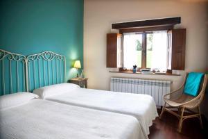 Ein Bett oder Betten in einem Zimmer der Unterkunft La Casa de la Abuela Milagros