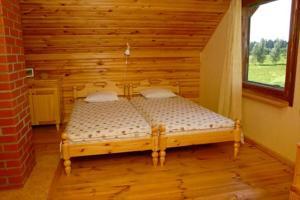 A bed or beds in a room at Brīvdienu māja Vīteri