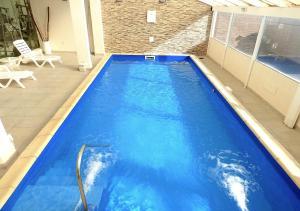 The swimming pool at or near Hotel Australis Yene Hue
