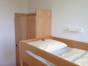 A bed or beds in a room at Jugendherberge Stuttgart Neckarpark