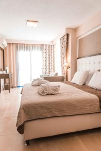 Ένα ή περισσότερα κρεβάτια σε δωμάτιο στο Secret Paradise Hotel & Spa