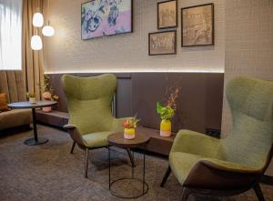 A seating area at Hotel Essener Hof; Sure Hotel Collection by Best Western