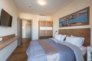 Een bed of bedden in een kamer bij Pelopas