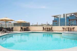 The swimming pool at or near Howard Johnson Plaza by Wyndham Dubai Deira