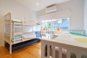 A bunk bed or bunk beds in a room at Our Escape at Rye - Modern Beachouse