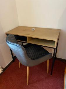 Ein Sitzbereich in der Unterkunft Bed & Rooms, Wörgl
