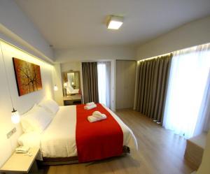 Letto o letti in una camera di Aura Boutique Hotel
