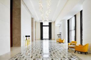 The lobby or reception area at Holiday Inn Dubai Al-Maktoum Airport, an IHG Hotel