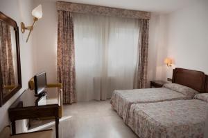 Cama o camas de una habitación en Hotel Juanito