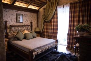 Кровать или кровати в номере Rassl Country Home