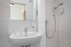 Ein Badezimmer in der Unterkunft Novum Hotel Alster Hamburg St. Georg