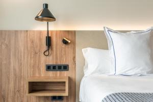 Cama o camas de una habitación en Hotel THe Lumm