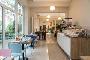 Ein Restaurant oder anderes Speiselokal in der Unterkunft Nu Wave Hotel Berlin