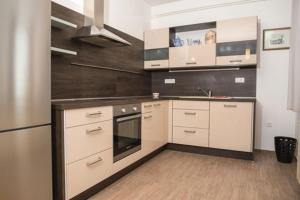 Cuisine ou kitchenette dans l'établissement Villa Carmen Rooms & Apartments