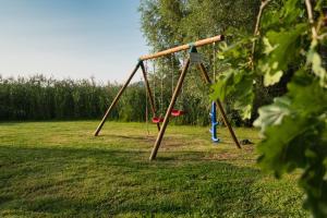 Children's play area at Hôtel du Golf de l'Ailette, The Originals Relais (Qualys-Hotel)
