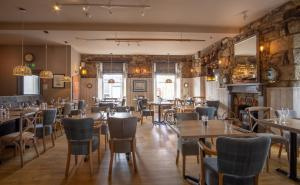 A restaurant or other place to eat at Marazion Hotel