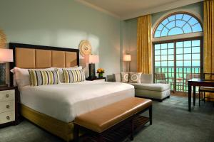 A bed or beds in a room at The Ritz-Carlton, Naples