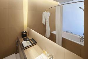 A bathroom at Ramada by Wyndham Singapore at Zhongshan Park (SG Clean)
