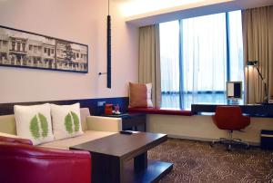 A seating area at Ramada by Wyndham Singapore at Zhongshan Park (SG Clean)