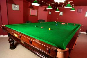 A pool table at Royal York & Faulkner Hotel