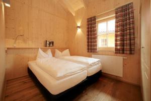سرير أو أسرّة في غرفة في فيغيندوف أوبيهايت