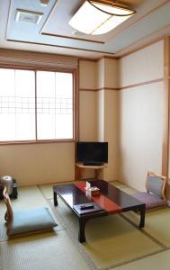 A television and/or entertainment center at Akita Onsen Plaza