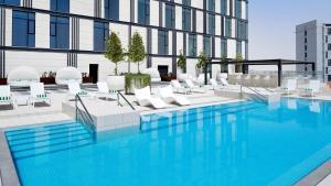 The swimming pool at or near Holiday Inn Dubai Al-Maktoum Airport, an IHG Hotel