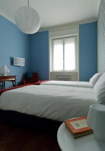 A bed or beds in a room at Casa Titta