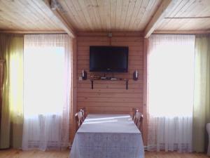 Телевизор и/или развлекательный центр в Усадьба Загородный дом