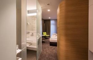A bathroom at Parkhotel Jordanbad