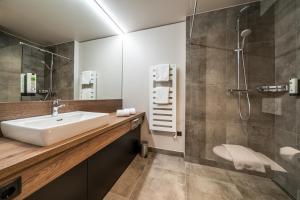 Ein Badezimmer in der Unterkunft Rufi's Hotel & Apartments