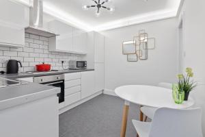 A cozinha ou cozinha compacta de Belsize Park Boutique Accommodation