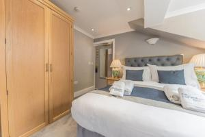 A bed or beds in a room at The Fisherbeck