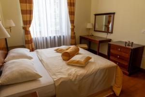 Postelja oz. postelje v sobi nastanitve Dvorec Jeruzalem