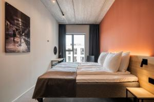 A bed or beds in a room at Citybox Antwerp