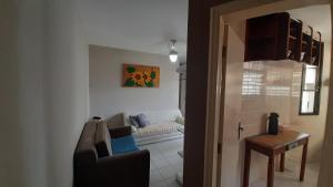 Uma área de estar em Apartamento Wembley Tenis - H402