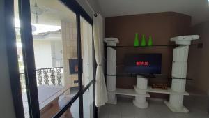 Um banheiro em Apartamento Wembley Tenis - H402