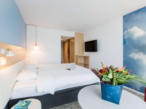 A bed or beds in a room at ibis Styles Aix les Bains